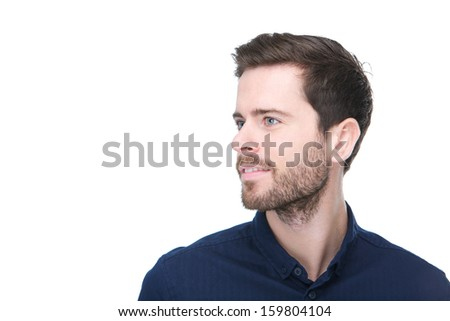 Profile portrait of a handsome young man looking away isolated on white