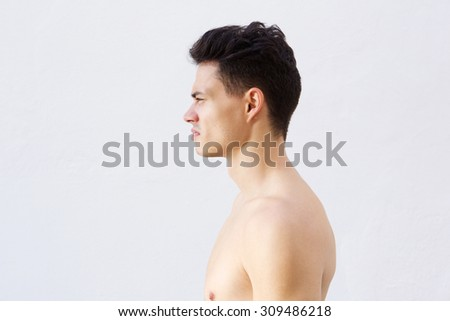 Profile portrait of a shirtless young man with cool hairstyle   - stock photo