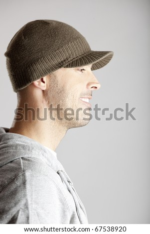 Profile portrait of a young man isolated on a gray background