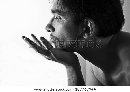 Profile portrait of a young unshaven man on white background - stock photo