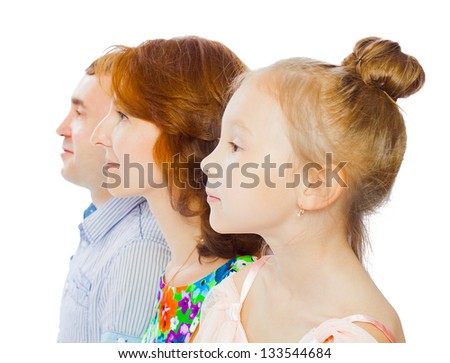Profile portrait of happy family with child posing on white background - stock photo