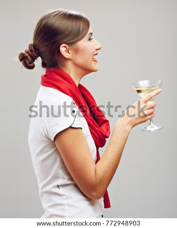 Profile portrait of smiling woman drinking alcohol. Isolated portrait.