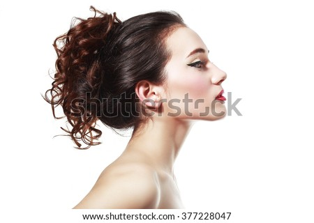 Profile portrait of the beautiful young girl - isolated on white background
