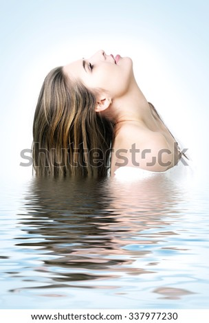 Profile  portrait of the beautiful young woman with long  hairs, reflected in waters  - stock photo