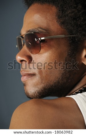 Profile Portrait of young african man wearing sunglasses