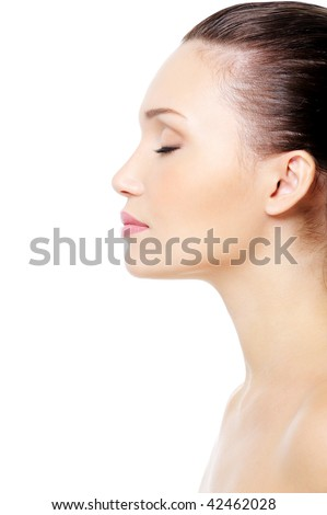 Profile portrait of young attractive caucasian female face with clean skin