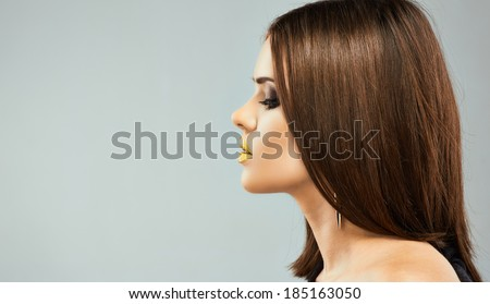 Profile portrait of young beautiful woman with straight hair.