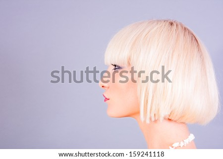 profile portrait of young blond woman - stock photo
