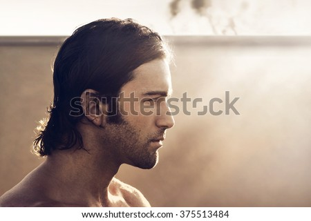 Profile portrait of young rugged man with vintage tone and style - stock photo