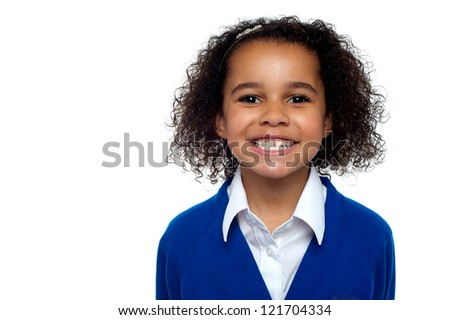 Profile shot of a cool and confident school girl grinding teeth in front of camera. - stock photo