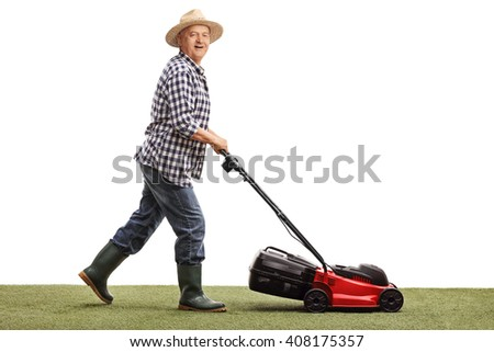 Profile shot of a mature man mowing a lawn with a lawnmower isolated on white background