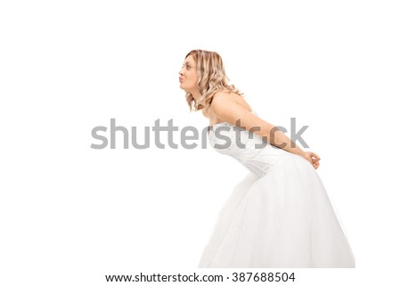 Profile shot of a young blond bride leaning to kiss someone isolated on white background