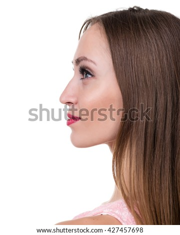 Profile side portrait of beautiful young woman, isolated over white - stock photo
