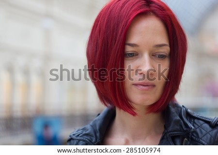 Profile side view of a young redhaired woman