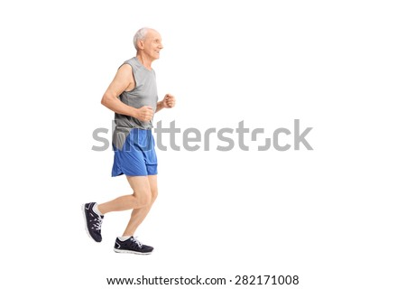 Profile studio shot of a cheerful senior jogging in sportswear isolated on white background  - stock photo
