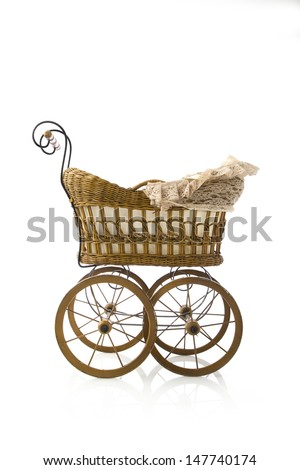Profile studio shot of old brown baby carriage on white background