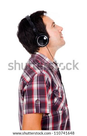 Profile view of a happy young man listening music. Isolated on white. - stock photo