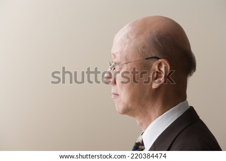Profile view of a mature man - stock photo