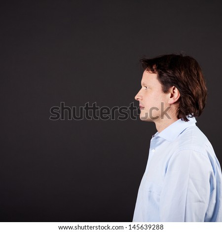 profile view of a mature, thoughtful man - stock photo