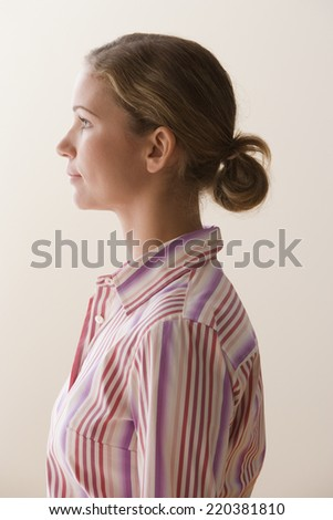 Profile view of a young woman - stock photo