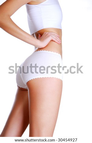 Profile view of beautiful woman  body  dressed in white underwear - stock photo