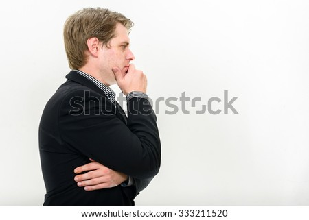 Profile view of businessman thinking