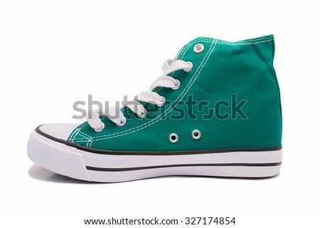 profile view of green sneaker isolated on a white background