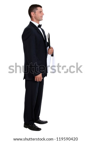 Profile view of male waiter - stock photo