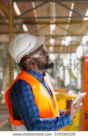 Profiled African american engineer at work using tablet computer