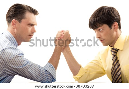 Profiles of two businessmen looking at each other during arm wrestling - stock photo