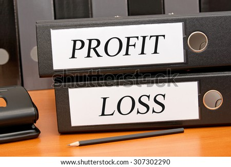 Profit and Loss - two binders with text on desk in the office