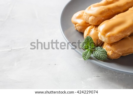 Profiteroles, choux with a custard cream, creme anglaise, dessert on  plate. selective focus - stock photo