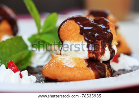 profiteroles with ice cream chocolate on plate