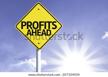 Profits Ahead road sign with sun background  - stock photo
