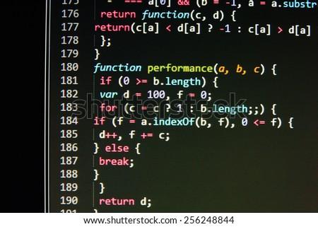 Program source code on monitor screen. Dark color. - stock photo