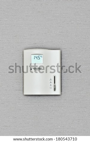 program the thermostat for heating a room - stock photo
