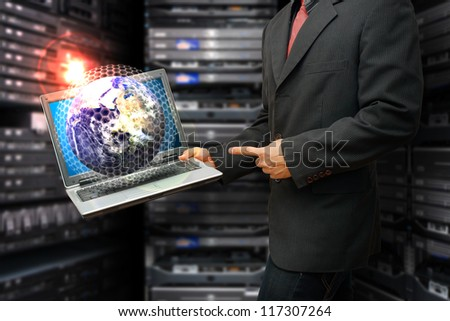 Programmer and global system control  on laptop : Elements of this image furnished by NASA - stock photo