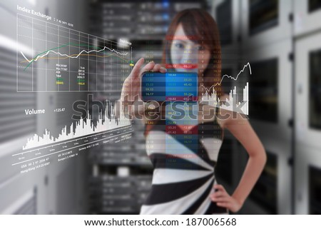 Programmer and graph report  in data center room - stock photo