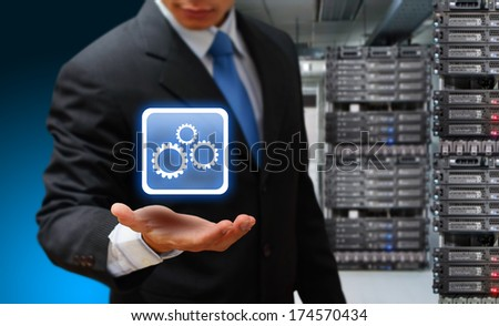 Programmer and icon control the server room - stock photo