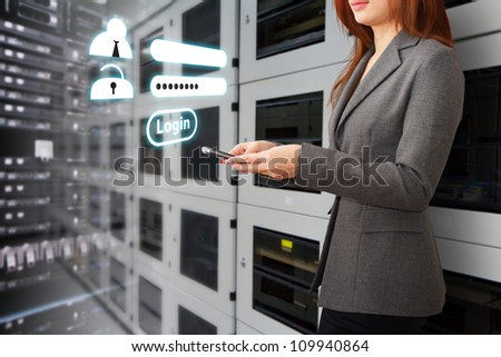 Programmer and Login window activated in data center room - stock photo