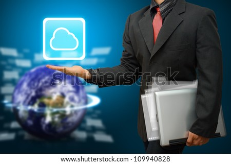 Programmer hold Cloud computing icon : Elements of this image furnished by NASA - stock photo