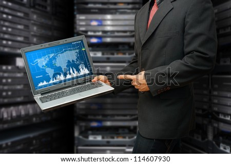 Programmer in data center room and graph for monitor the system - stock photo