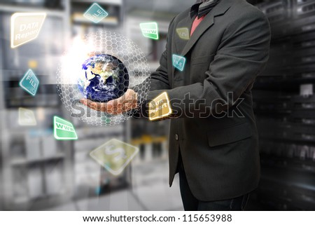 Programmer in data center room and take control the digital world : Elements of this image furnished by NASA - stock photo