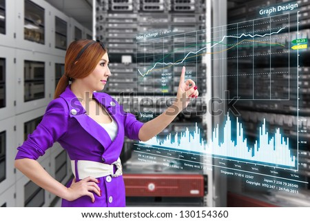Programmer in data center room with monitor graph - stock photo