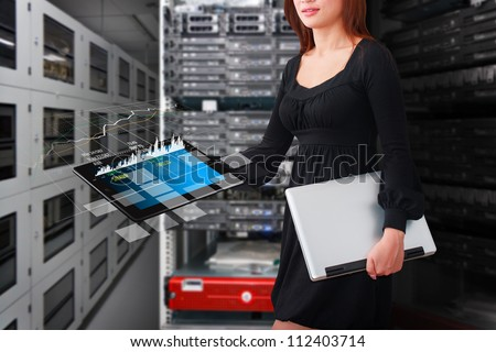 Programmer in data center room with tablet - stock photo