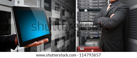 Programmer in data center room with touch pad