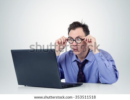 Programmer in glasses with laptop