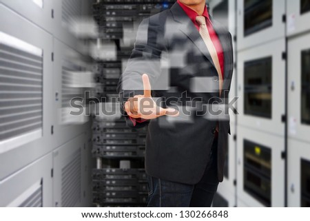 Programmer press on button in data center room