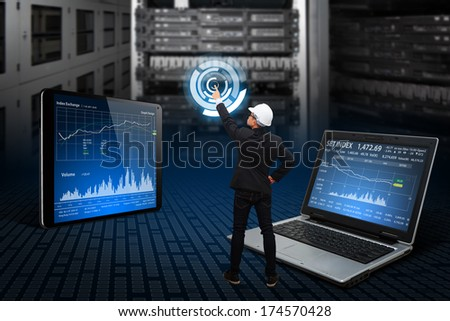 Programmer press on power icon in server room - stock photo