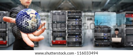 Programmer team in data center room for service : Elements of this image furnished by NASA